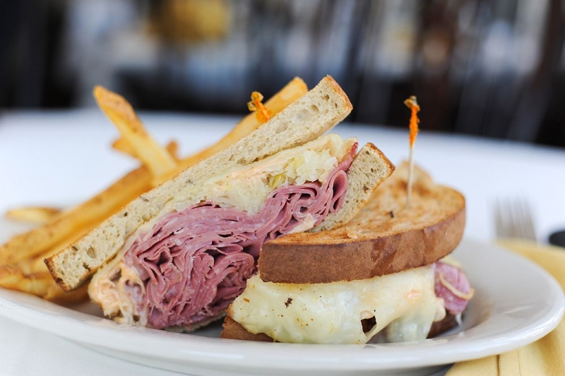 Reuben with cheese and french fries