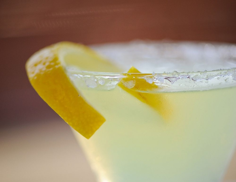 Lemon drop cocktail with sugar rim and lemon peel
