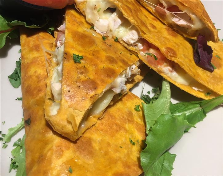 plate of chicken quesadillas cut into triangles