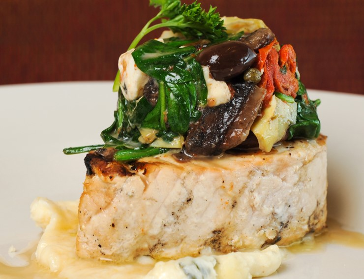 TUSCAN SWORDFISH: grilled swordfish topped with spinach, feta, sun-dried tomatoes, artichokes, olives, capers, portobello mushrooms and tarragon butter sauce,