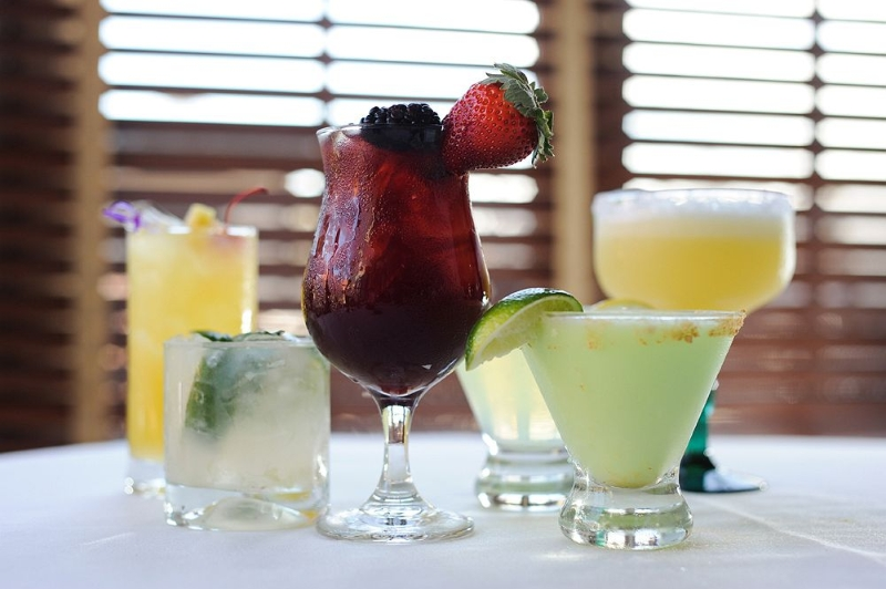 Variety of cocktails with fruit garnishes