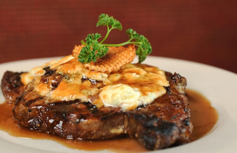 Steak with melted cheese
