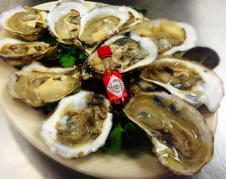 Raw oysters with mini bottle of tabasco