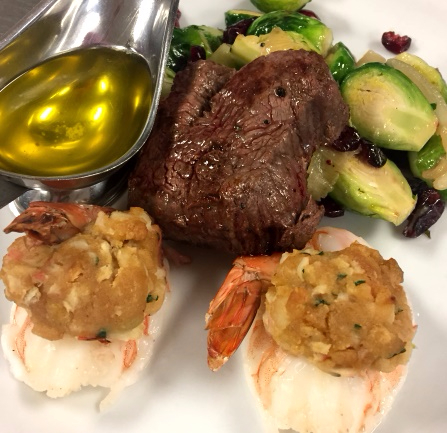 Steak with brussel sprouts, lobster tail, and melted butter