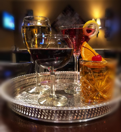 Metal tray with four classes of wine