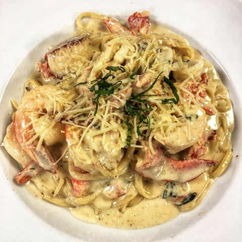 Lobster ravioli with lobster claw and shaved paremsan cheese
