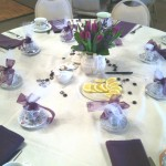Table setup for a tea party with a flower center piece