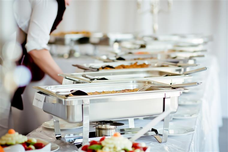 buffet setup with assorted entrees for a corporate event