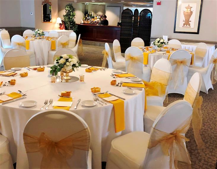 catering hall dining room setup with table cloths and place settings