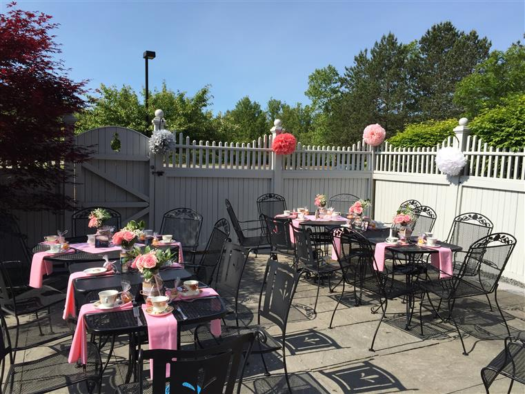 outside patio setup for a girl's baby shower