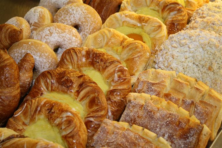 assorted danishes, croissants and other pastries on display