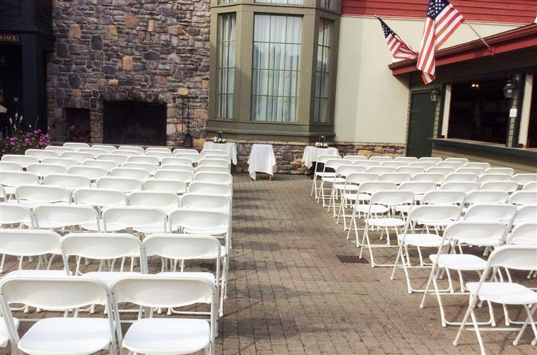 wedding ceremony setup on the outside patio