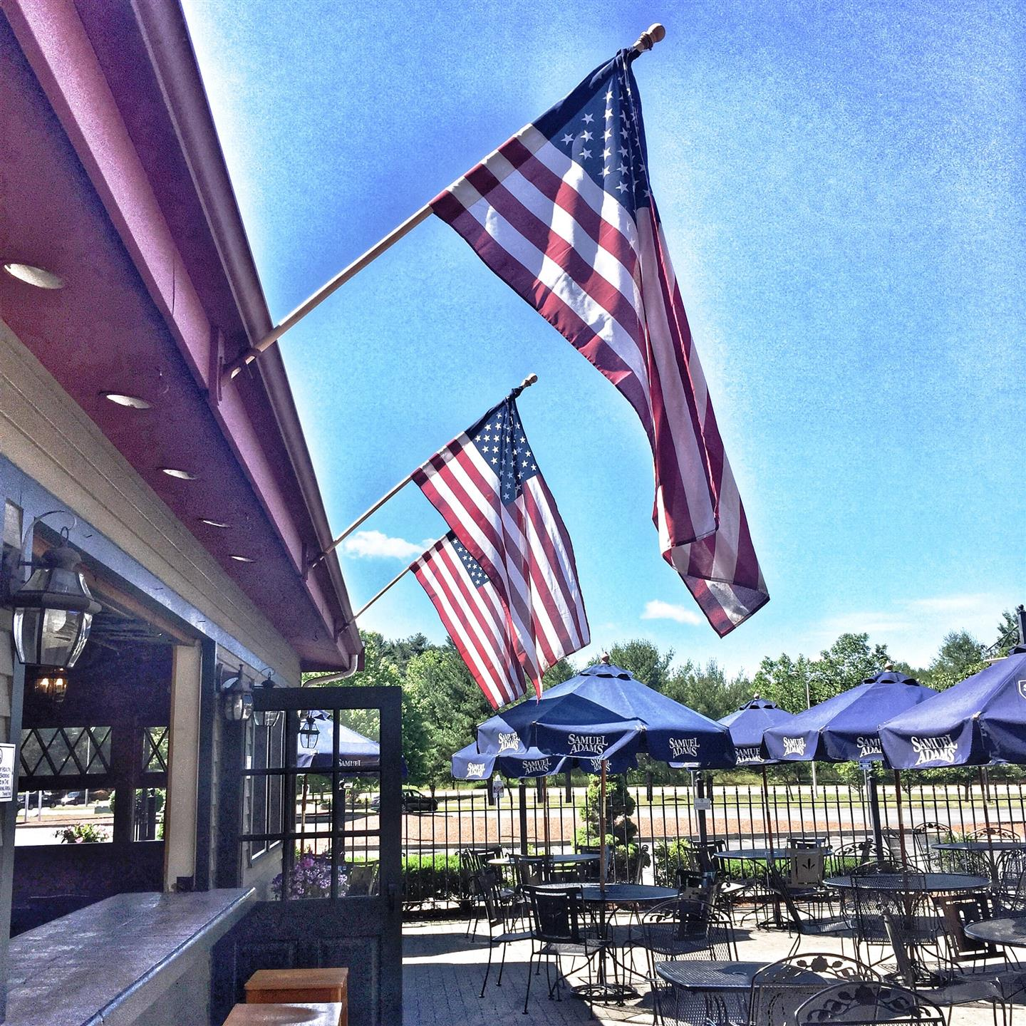 Outdoor patio with american flags