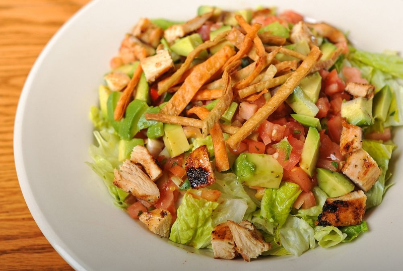 Salad with grilled chicken and crispy tortilla strips