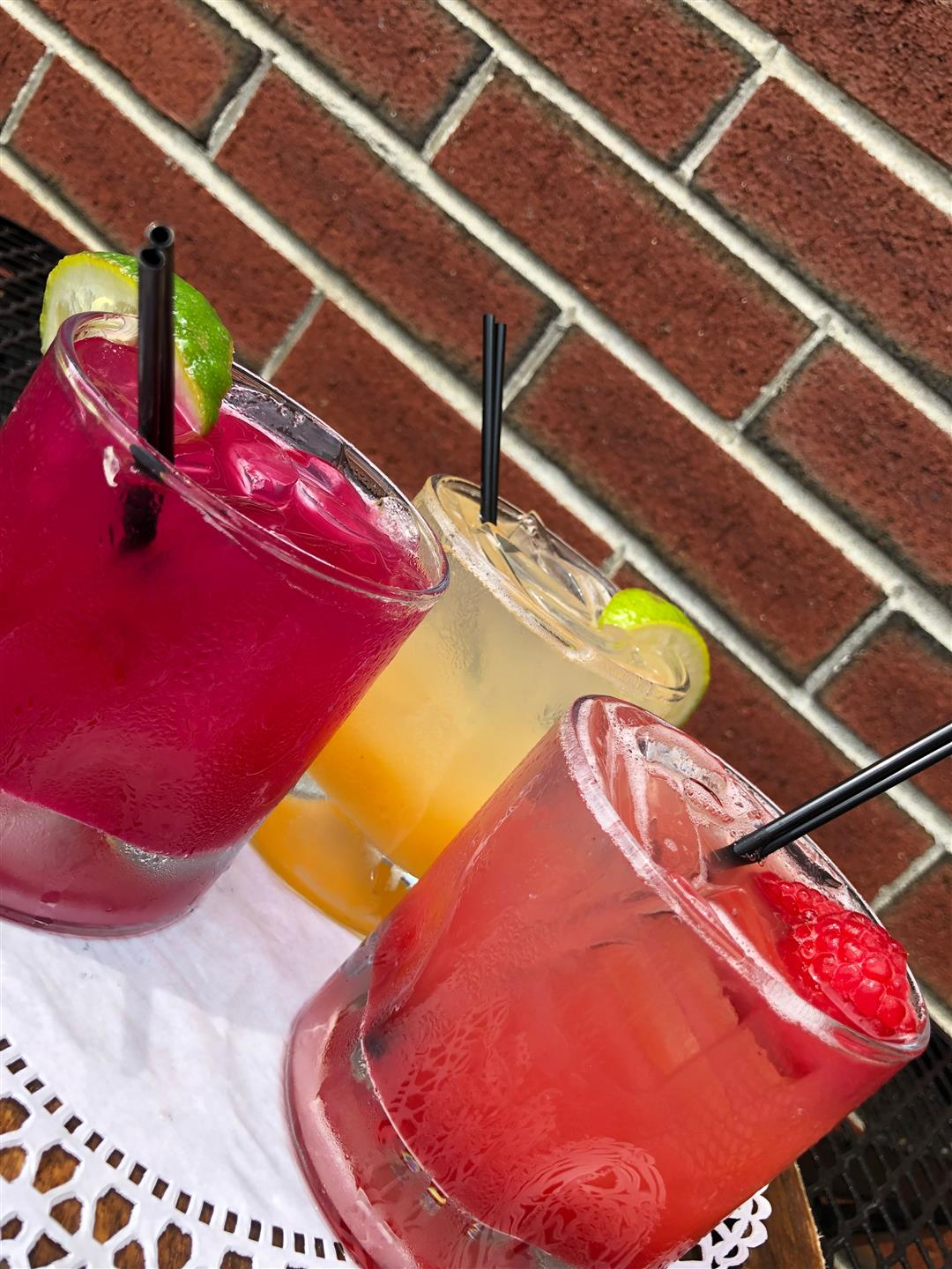 Three summer cocktails with fruit