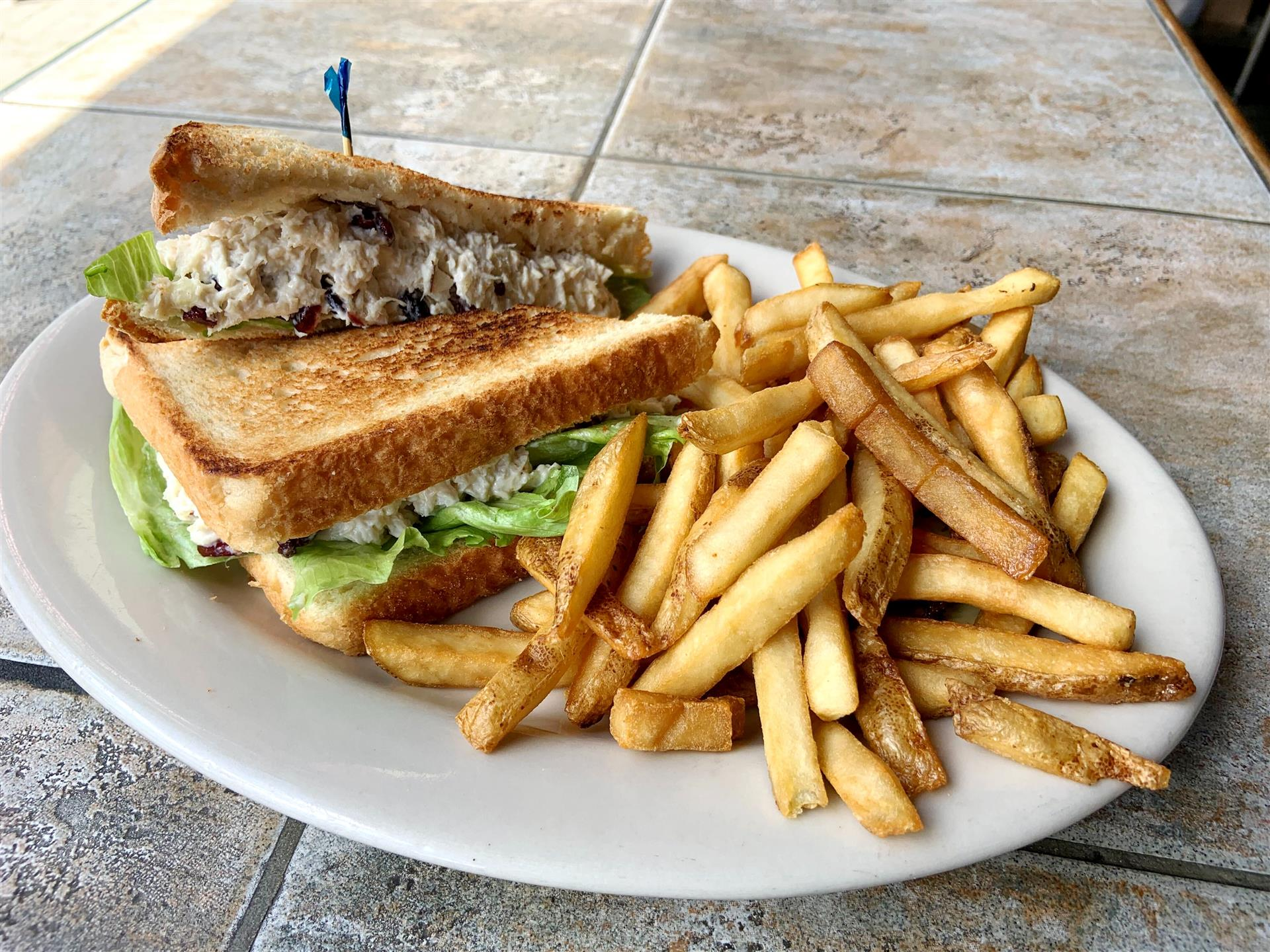 Apple Cranberry Chicken salad sandwich with french fries