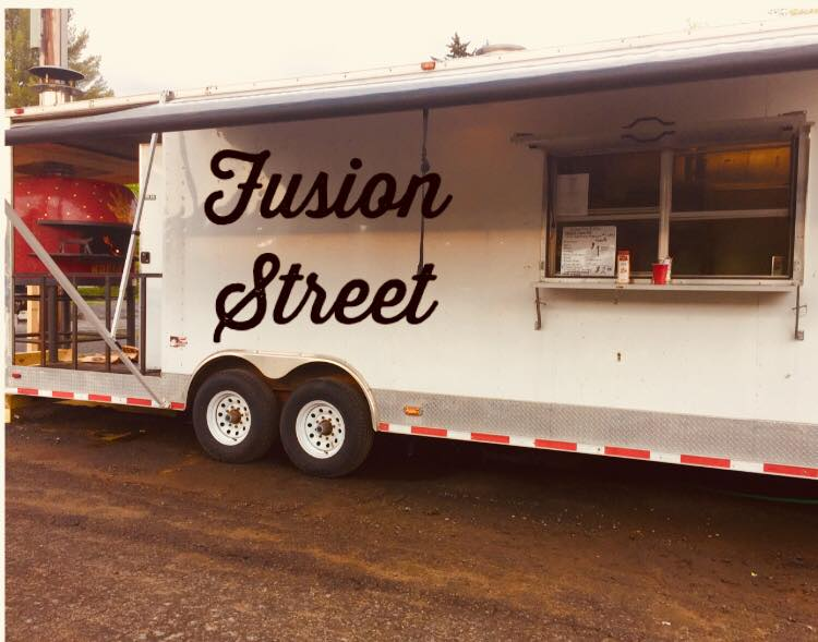 Food truck with pizza oven with Fusion Street Label on side