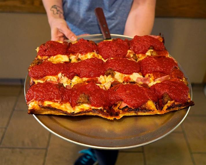 Detroit style square pizza on a tray