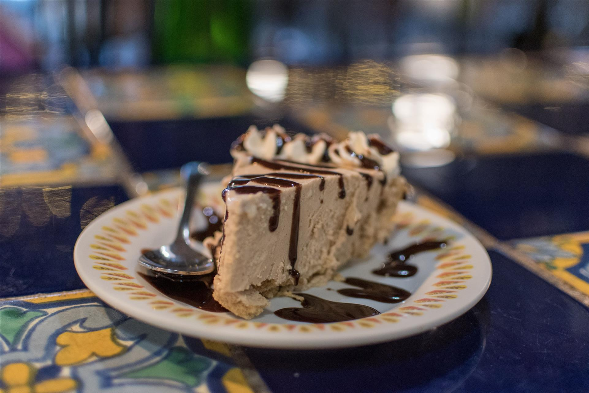peanutbutter pie topped with chocolate syrup