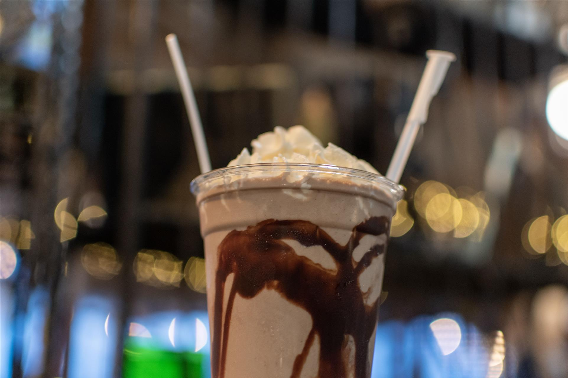 peanutbutter milkshake with choclate syrup and topped with whipped cream