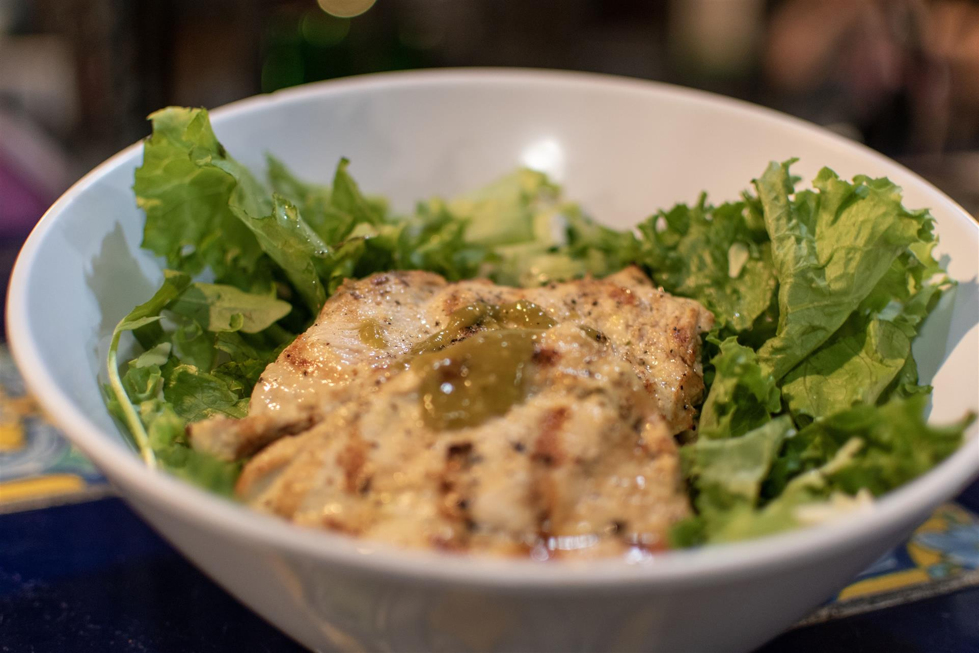 caesar sald topped with grilled chicken