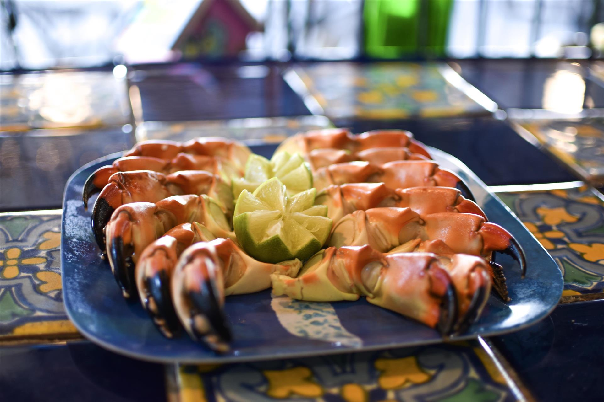 assortment of crab claws with a side of dipping sauce