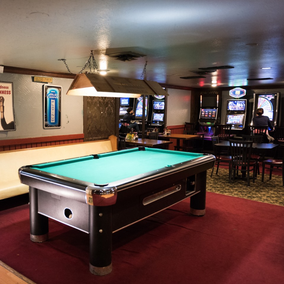 interior shot of the building with a pool table