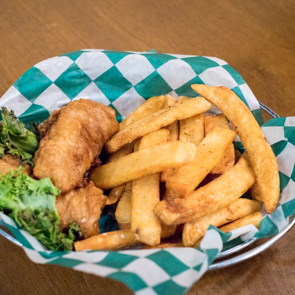 fried cod fish in a basket with fries