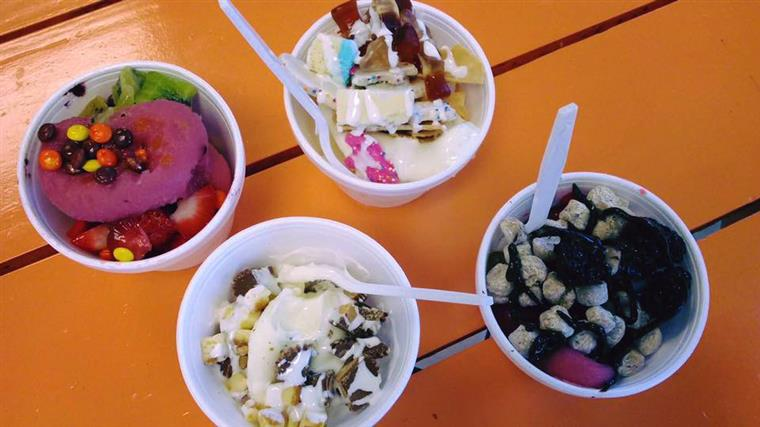 4 cups of frozen yogurt with addorted candy toppings