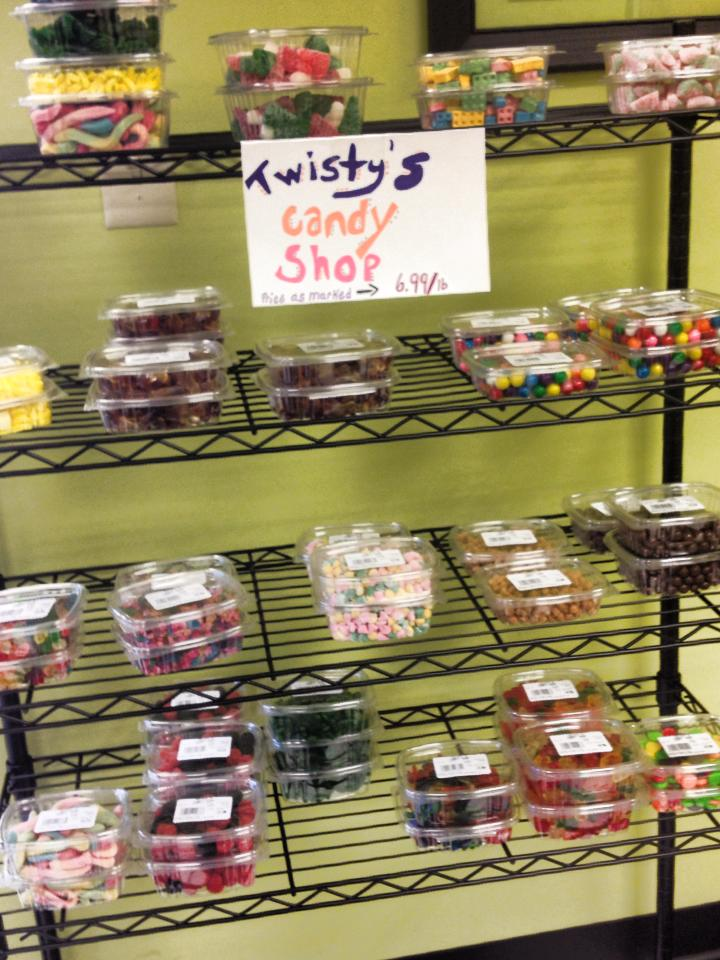 Shelves with containers of candy