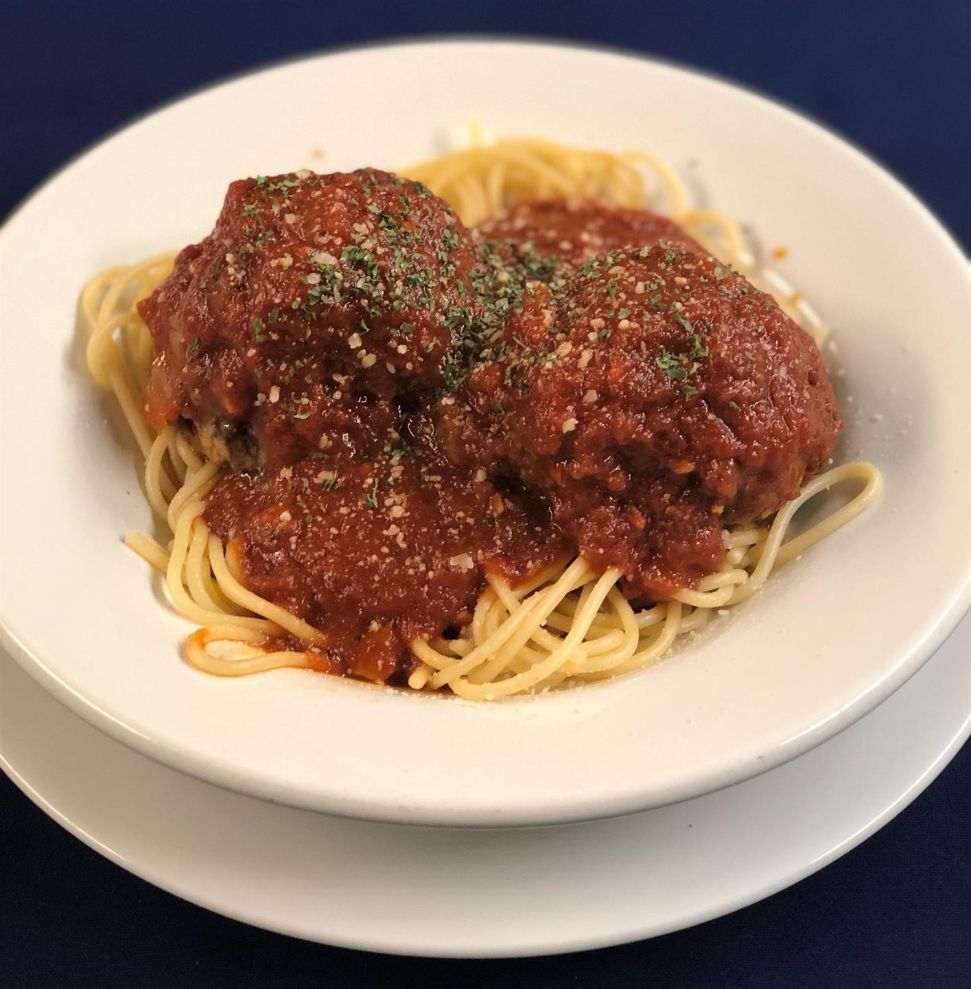 spaghetti and meatballs covered in marinara sauce