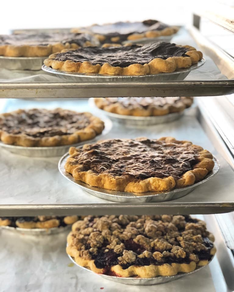 assortment of pies on baking shelf