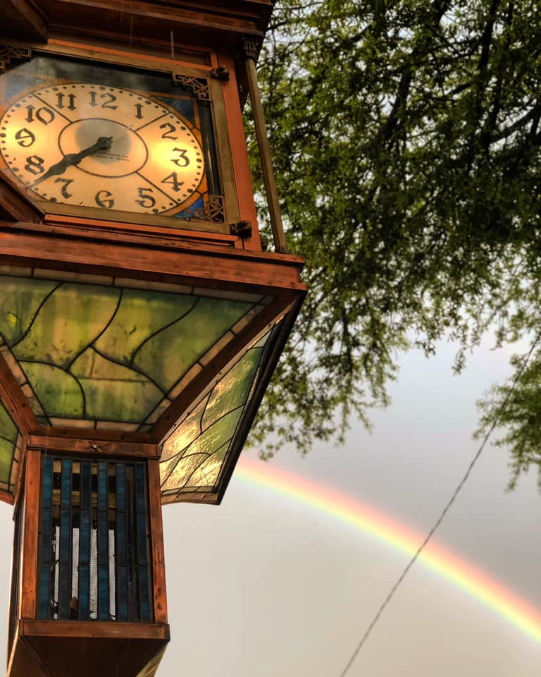 clocktower with rainbow in the background