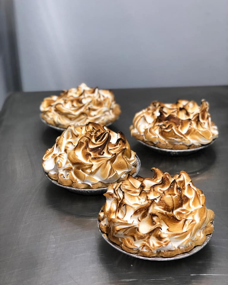 assortment of smores pies topped with whipped cream