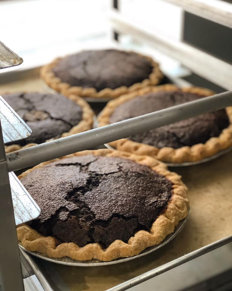 assortment of chocolate pudding pies