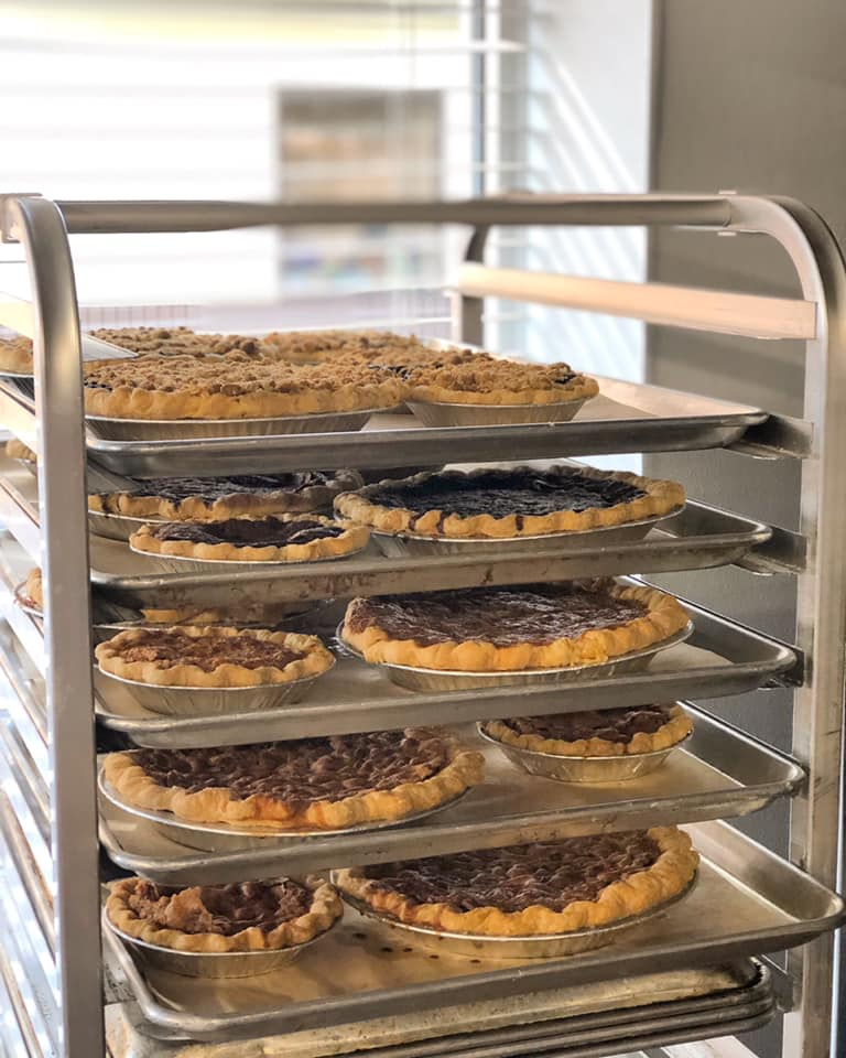 assortment of pies resting on a rack