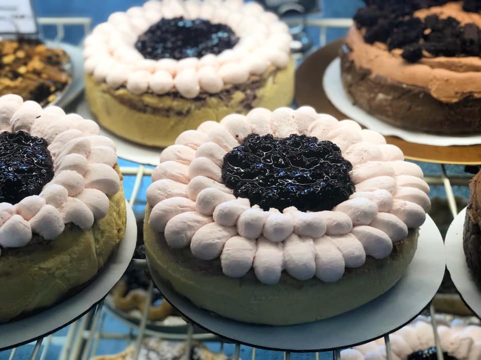 assortment of blueberry cheesecakes on a rack