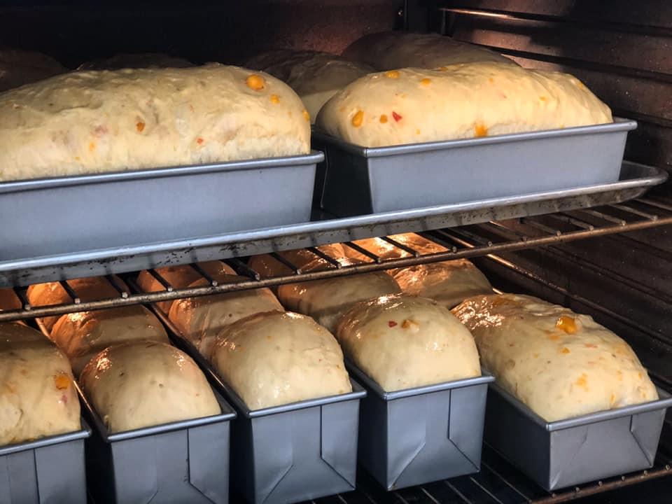 assortment of breads baking in the oven