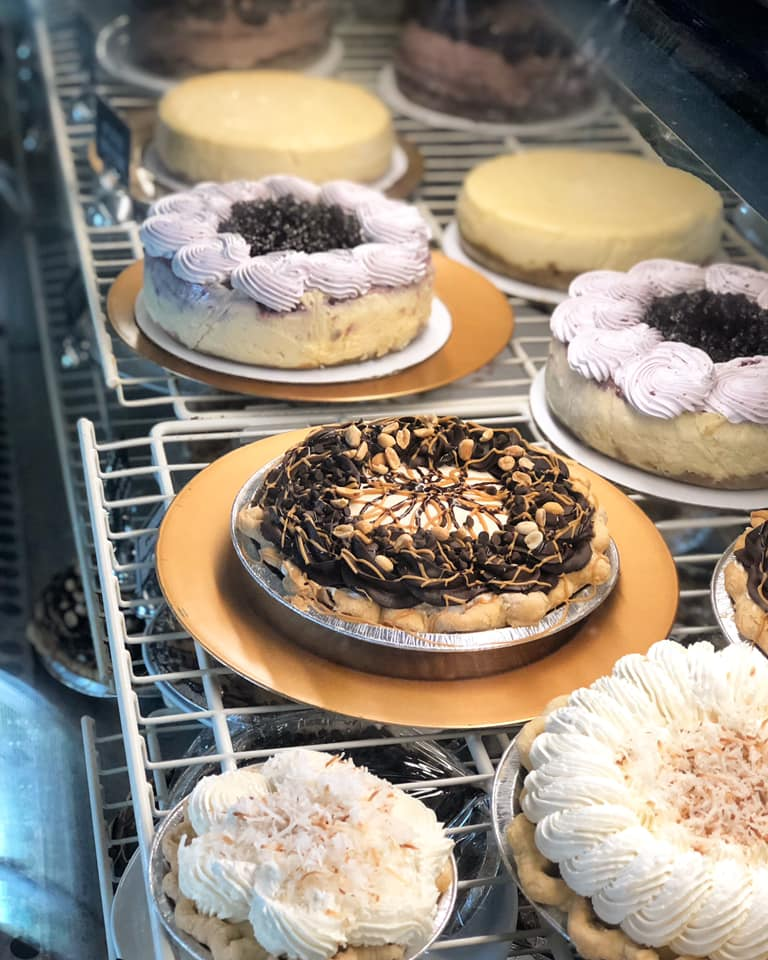 assortment of fresh pies and cakes on racks