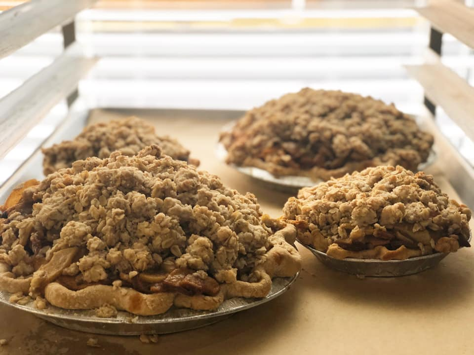 assortment of apple crumb pies sitting on a pan