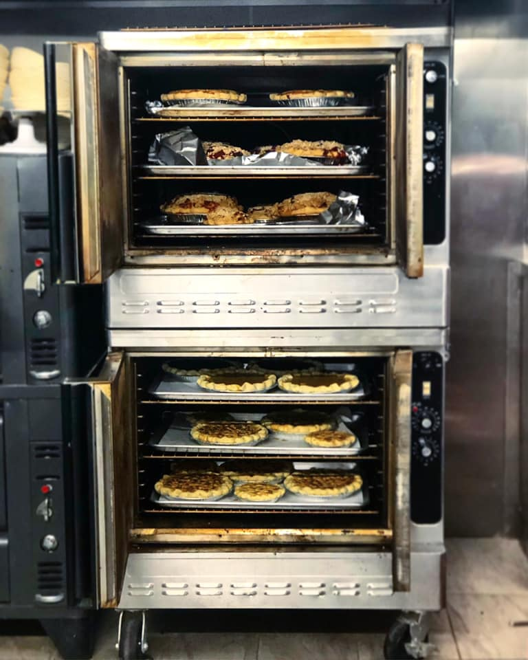 assortment of pies baking in a convection oven