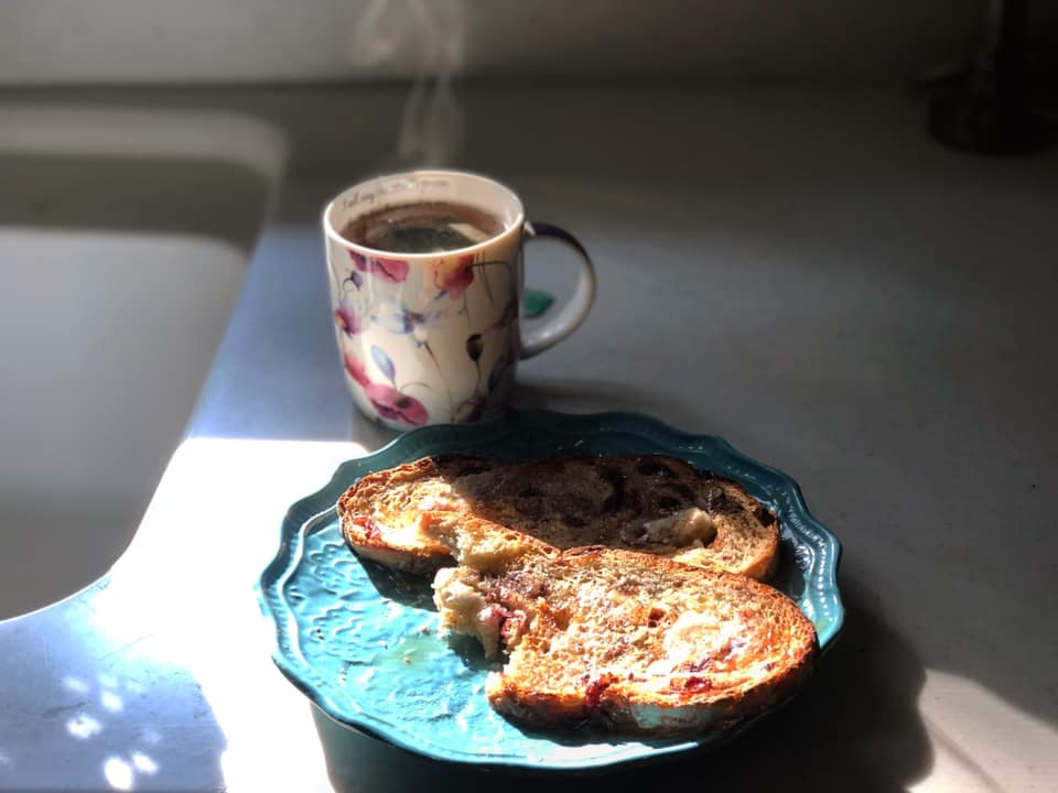 sliced toast on a plate with a cup of coffee