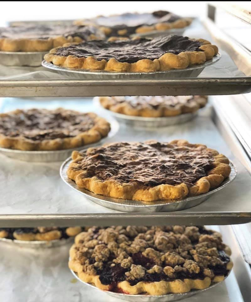 assortment of pies on baking shelves