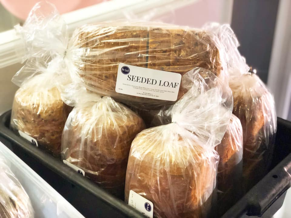 assortment of shredded loafs of bread wrapped up in a bin