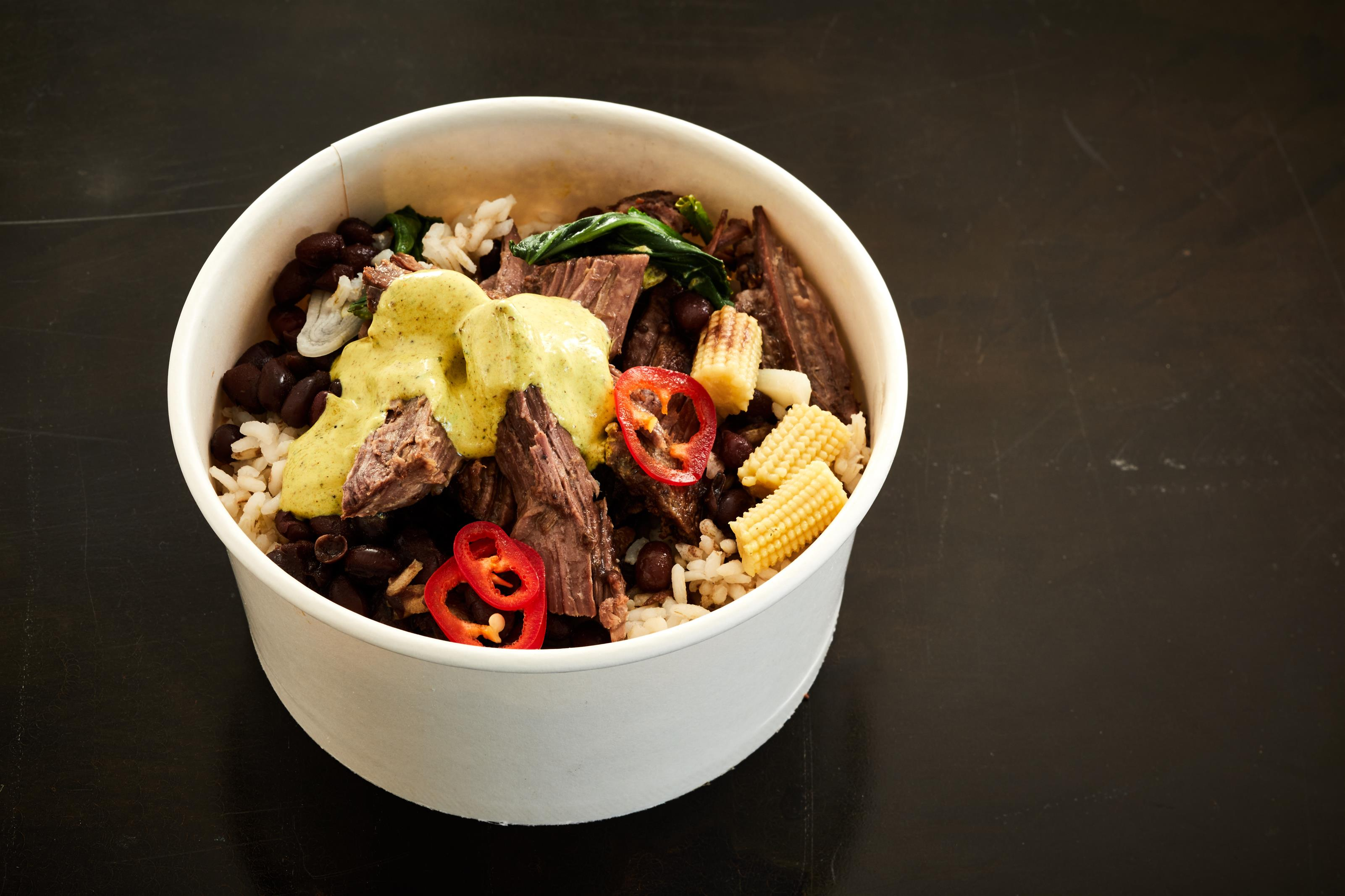 BRAISED BEEF bowl. Texas Brown Rice, spicy black beans, turmeric yogurt
