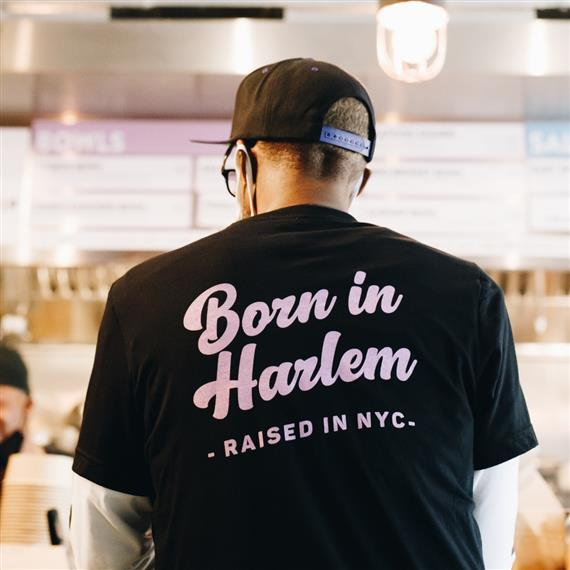 "fieldtrip employee waering a shirt that says ""Born in Harlem. Raised in NYC"""