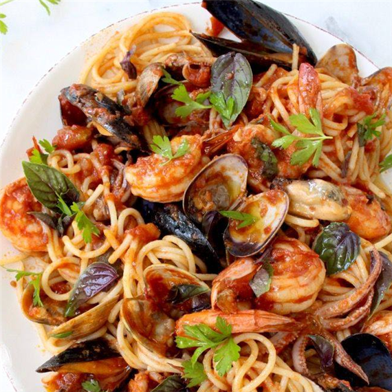 Shrimp, calamari, clams and mussels in a plum tomato basil sauce