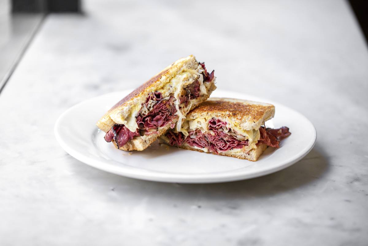 Pastrami with cole slaw on toasted rye bread