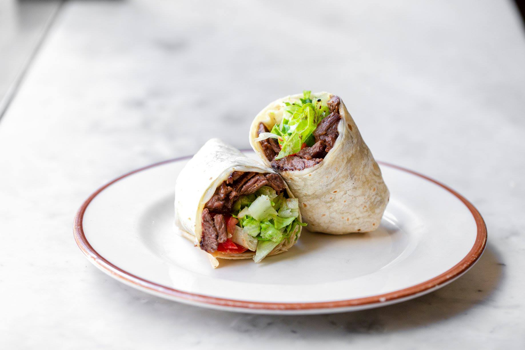 Steak wrap with lettuce on plate