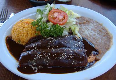 Enchiladas Mole. Three chicken enchiladas topped with our homemade mole sauce. Served with rice and beans.